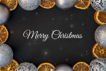 Christmas card with stars and a frame of silver Christmas balls and dried orange