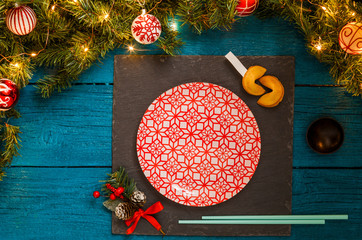 Picture of New Year branches of fir, black board, sushi sticks, prediction cookies