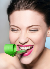 Smiling woman blowing noisemaker