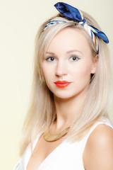 Portrait beautiful blonde woman pinup girl retro style