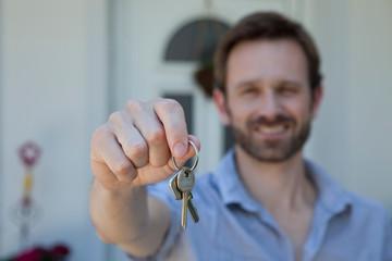 Man offering set of keys