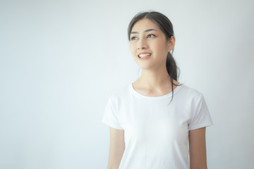 Portrait of Attractive Asian Woman smiling on white background.