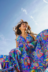 Woman outdoors laughing