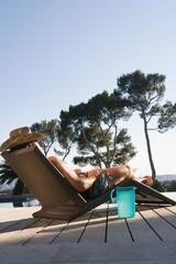 Man lying on sun lounger
