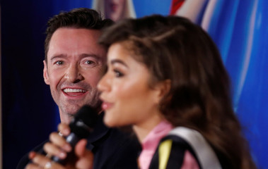"Australian actor Hugh Jackman smiles next to American actor Zendaya at a news conference ahead of a premiere of their film, a musical directed by Michael Gracey called ""The Greatest Showman"", in Mexico City"