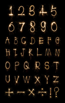 Alphabet and Numbers sparklers on black background