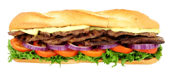 Foto auf Acrylglas Fastfood Beef steak and salad filled crusty baguette sandwich isolated on a white background