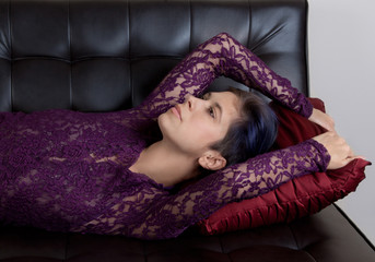 Woman in Lacy Purple Top Relaxing on Couch