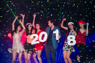 New Year 2018 Party - Group of Friends Enjoy Throwing Confetti and Dancing in Nightclub