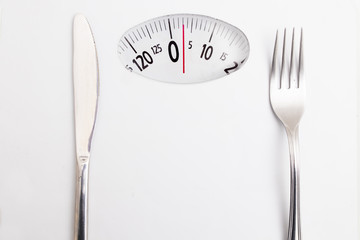 scales with fork and knife, diet and slimming concept