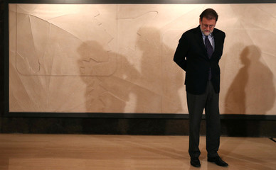 Spanish PM Rajoy is seen during a visit at the Freixenet Cava producer in Sant Sadurni d'Anoia