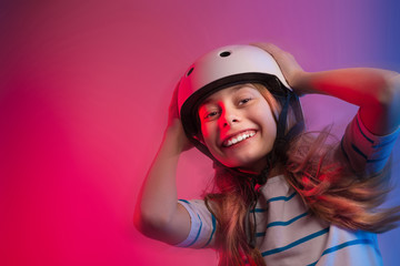 Young child girl in skate helmet - safety and sports