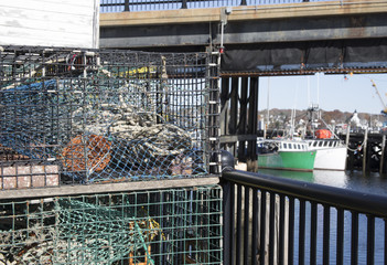 Colorful lobster traps next to rustic shed on waterfront
