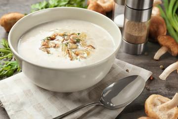 Bowl of creamy shiitake mushroom soup on table