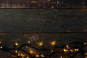 Christmas garland lights on grey wooden table