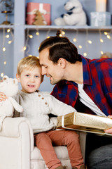 New Year's image of son and father with gift
