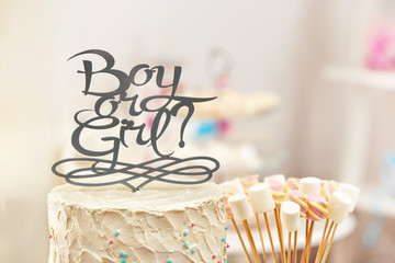 """""""Boy or girl"""" cake for baby shower party, closeup"""