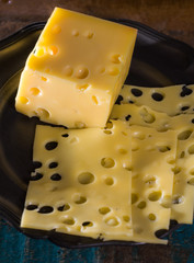 Yellow medium-hard mild Swiss cheese Emmental