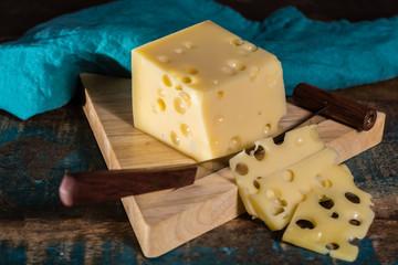 Yellow medium-hard mild Swiss cheese Emmental