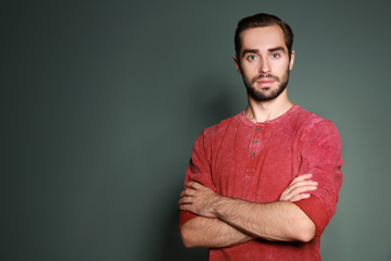 Young handsome man on color background