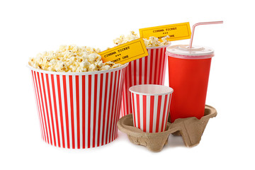 Cups with popcorn, soda and cinema tickets on white background