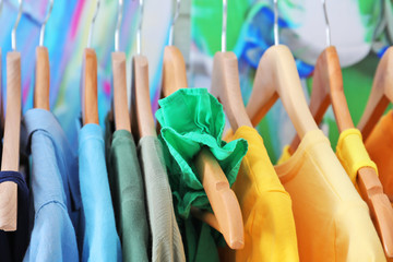 Wall Mural - Hangers with color clothes, close up