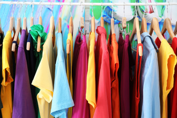 Rainbow clothes hanging on rack