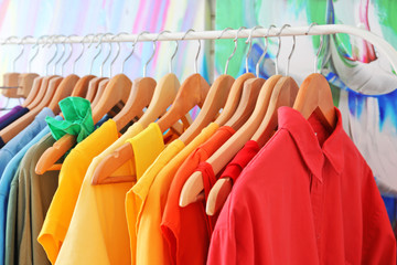 Wall Mural - Color clothes hanging on rack