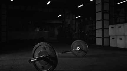 Heavy barbell on the floor of a gym studio