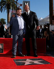 Actor Johnson poses on his star with actor Black after it was unveiled on the Hollywood Walk of Fame in Los Angeles