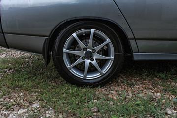 Sports car side view, alloy wheels