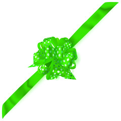 Beautiful big corner bow made of green ribbon in polka dots with shadow on white background