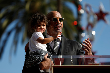 Actor Johnson holds his daughter Jasmine Lia before unveiling his star on the Hollywood Walk of Fame in Los Angeles