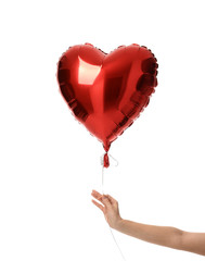 Woman hand hold single big  red heart balloon object for birthday party or valentine's day