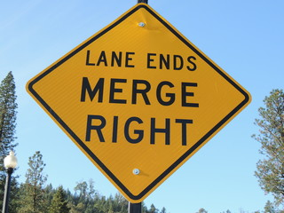lane ends merge right street sign