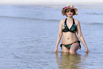 Woman shape pretty show with bikini relax on beach