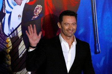 "Australian actor Hugh Jackman waves to photographers during the red carpet of his latest film, a musical directed by Michael Gracey called ""The Greatest Showman"", in Mexico City"