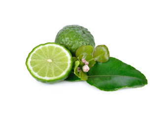 whole and half cut fresh bergamot with leaf on white background