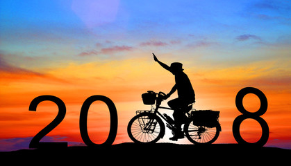 silhouette man driving with a bicycle,Happy new year 2018 concept.