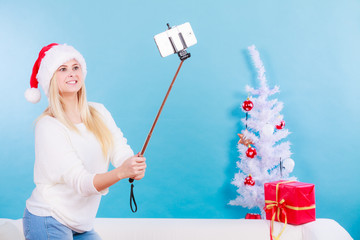 Woman in santa hat taking selfie