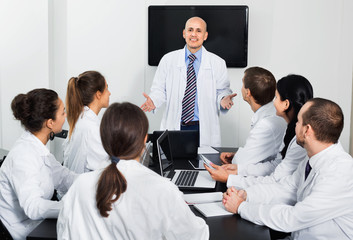 Scientist presenting report during working meeting