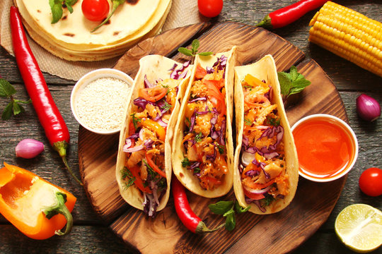 Mexican food tacos, fried chicken, greens, mango, avocado, pepper, red cabbage