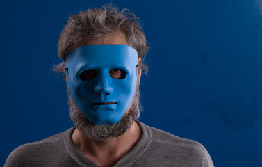 portrait of a man in a blue mask