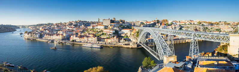 Very large panoramic view on Dom Luis I bridge and Douro River at sunset time. Porto. Portugal