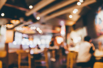 In de dag Restaurant Restaurant cafe or coffee shop interior with people abstract blur background