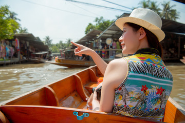 smiling young female traveler take on river boat