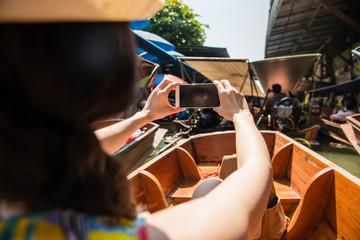back view of female traveler sitting on river boat