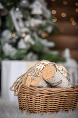 homemade cozy Christmas background. Firewood cart under the tree Christmas