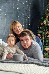 Happy family celebrates Christmas at home