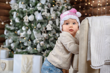 Happy baby girl under the Christmas tree home